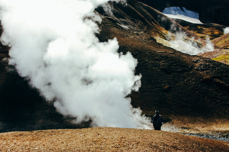Hiking in Landmannalaugar  mountain landscape with steam in Iceland