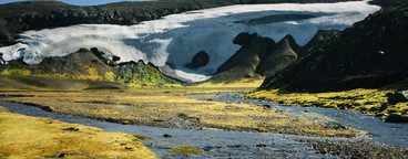 Landscape with moss  river and snow in Iceland  Mountain tourism