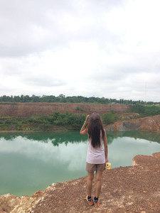 Young woman looking view of lake