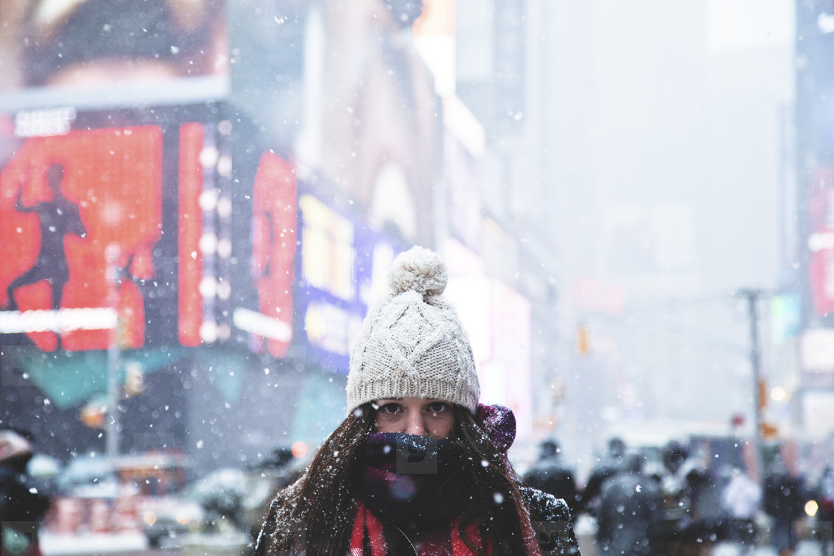 Girl with beanie in blizzard
