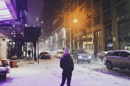Girl standing in NYC snow