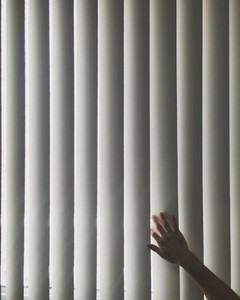 Hand touching blinds