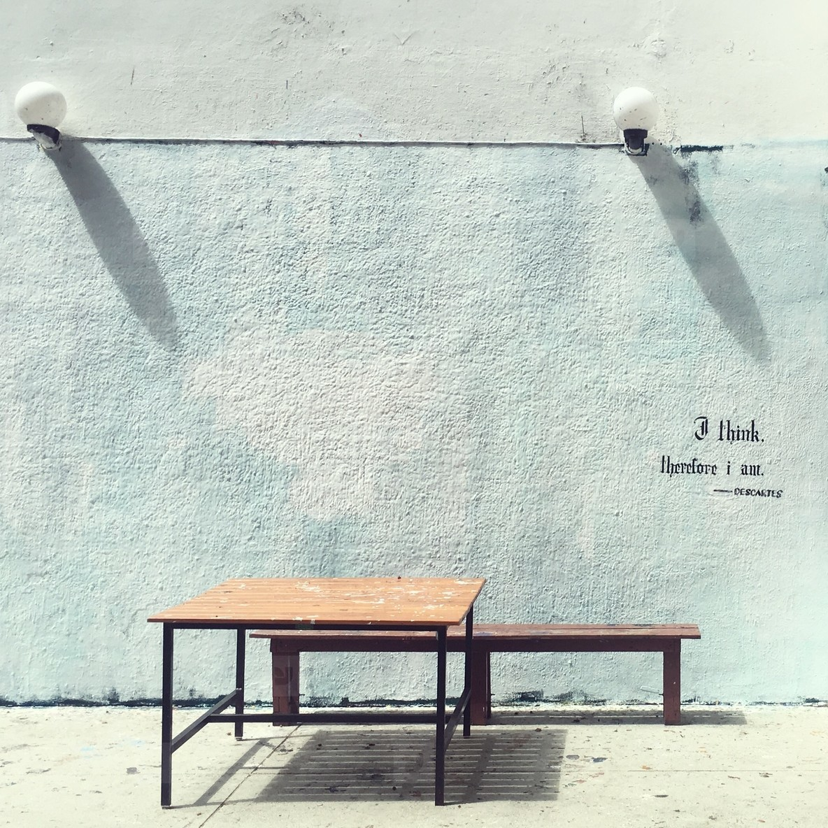 Table and Blue concrete wall