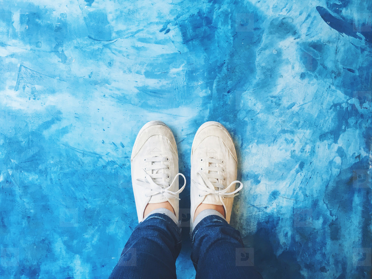 Selfie of feet on blue floor