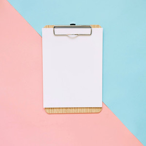 Blank clipboard on pastel color