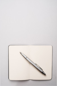 Blank open notebook with pen