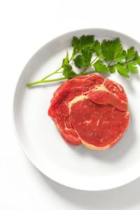 Raw steak on a plate