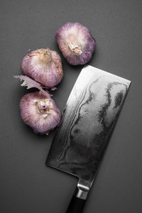 Fresh garlic and knife
