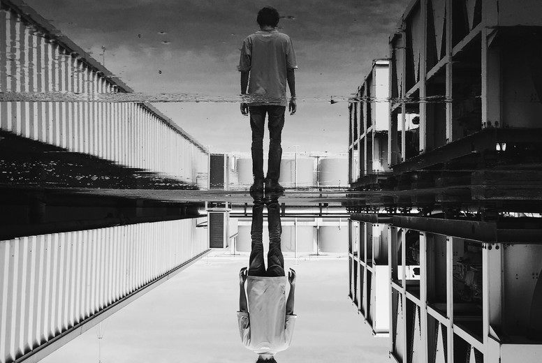 A man standing with reflected