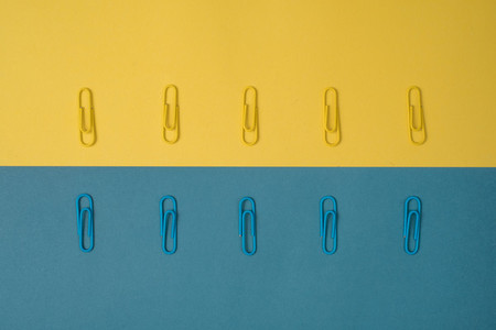 Blue and yellow paper clips