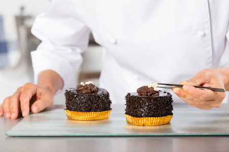 Chef finishing a cake