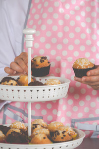Girl placing muffins