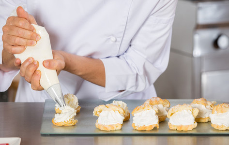 Pastry chef decorating