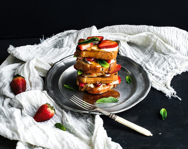 French toasts tower with strawberry  cream cheese  honey and mint