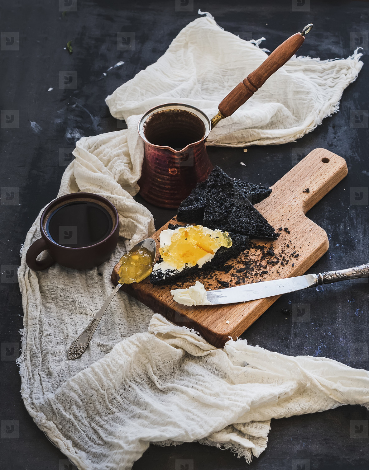 Breakfast set  Coffe  black toasts with cream cheese and orange marmalade on dark grunge table surface