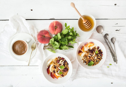 Healthy breakfast Bowl of oat granola with yogurt fresh fruit mint and honey
