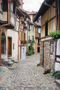 Street with half timbered medieval houses in Eguisheim village along the wine route  Alsace  France