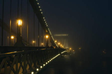 Chain Bridge in Budapest  Hungary  the fog  evening lights