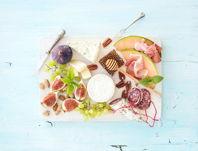 Wine snack set  Figs  grapes  nuts  cheese variety  meat appetizers and herbs