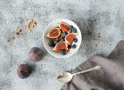 Healthy breakfast Bowl of oat granola with yogurt fresh blueberries and figs