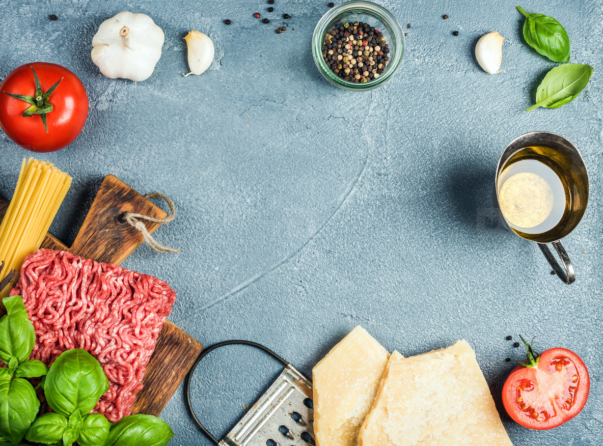 Ingredients for cooking pasta Bolognese on grey concrete background  top view