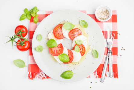 CLassic Italian Caprese salad with tomatoes  mozzarella di Buffala and fresh basil