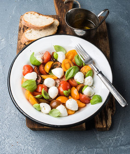 Italian Caprese salad with cherry tomatoes  small mozzarella and fresh basil