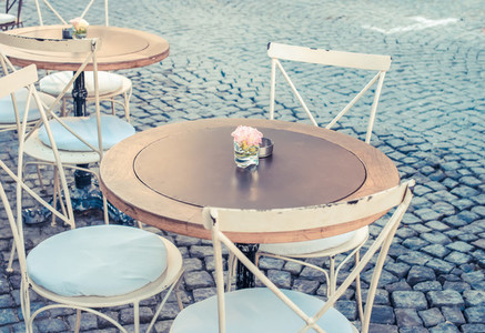 Vintage table and chairs in street cafe terrace  Alacati  Turkey