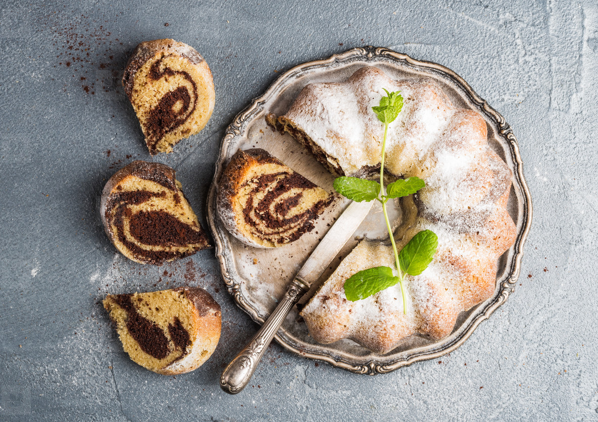 Zebra bundt cake cut into pieces and mint leaves