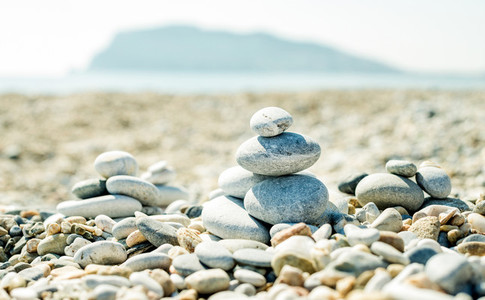 Pile of pebbles on the beach at Alanya Mediterranean sea coast Turkey  Balance relaxation and harmony concept