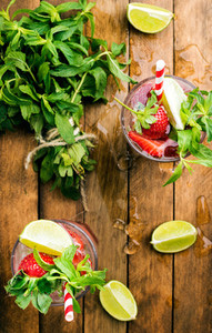 Strawberry mojito summer cocktails with mint and lime in glasses