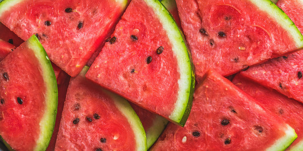 Sliced red ripe watermelon  Fruit background and texture