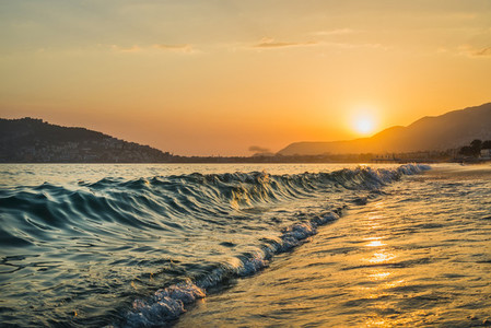 Sunset at the beach in Alanya  Turkey  View of the castle hill and sea