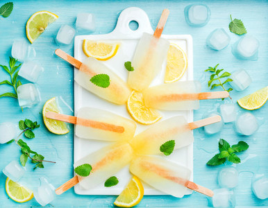 Homemade lemonade popsicles with mint and ice