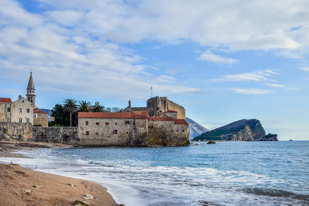 Budva Montenegro Beach near old town wall and fortress in wint