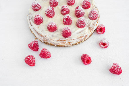 Raspberry cake on a white desk