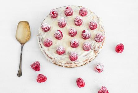 Raspberry cake on a white desk