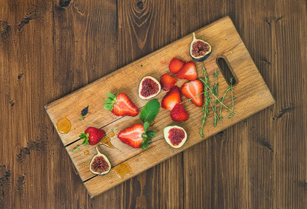 Fresh strawberries  figs  mint leaves  thyme and honey drops ob