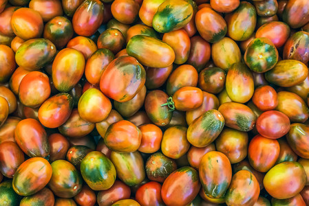Ripe kumato tomatoes on a market stall