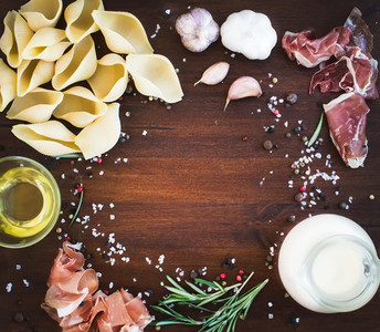 Carbonara pasta ingredients  conchiglioni  bacon  a jug of cream