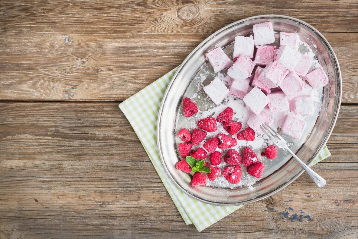 Homemade raspberry marshmallow with fresh raspberries and sugar
