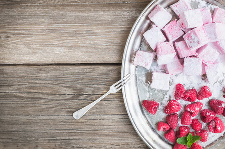 Homemade raspberry marshmallow with fresh raspberries and sugar