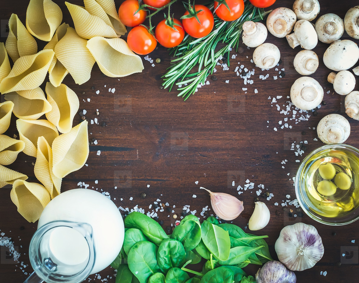 Pasta ingredients  conchiglioni mushrooms  a jug of cream  olive