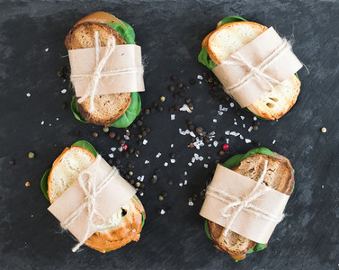 Chicken and spinach sandwiches wrapped in craft paper