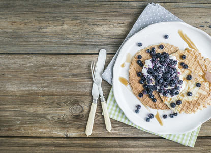 Dutch waffles with cream cheese fresh blueberry and maple syrup