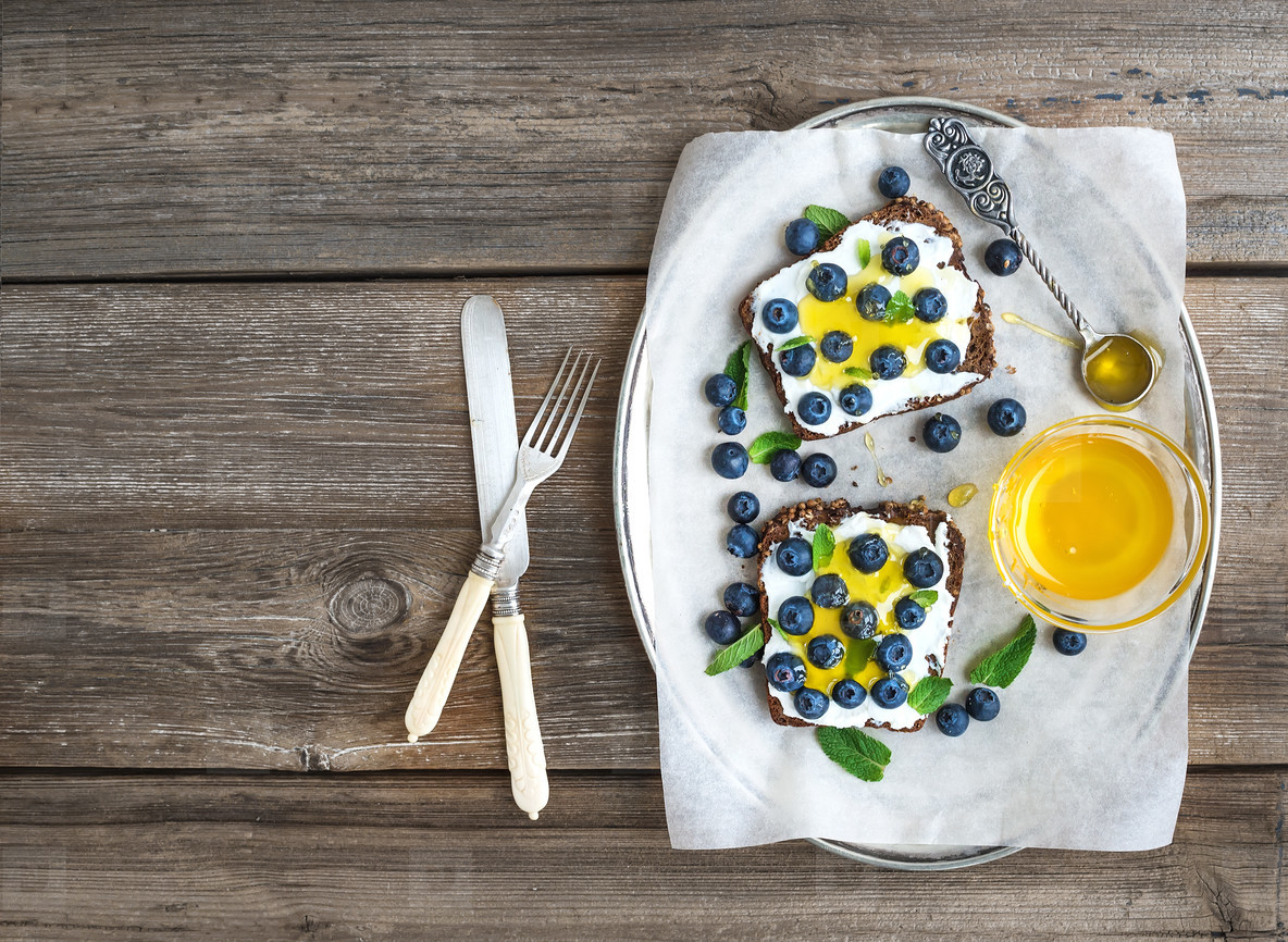 Healthy breakfast set with ricotta  fresh blueberries and honey