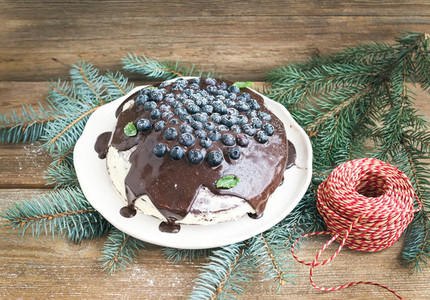 Christmas chocolate celebration cake with chocolate ganache cre
