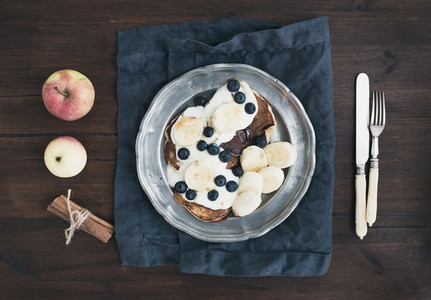 Breakfast set on dark wooden desk apple and cinnamon pancakes w