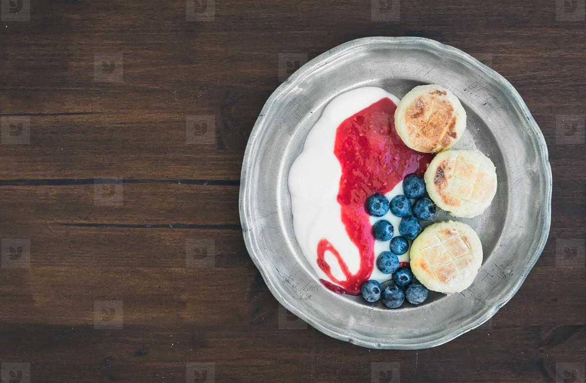 Breakfast set  curd pancakes with yogurt  fresh blueberry and ra