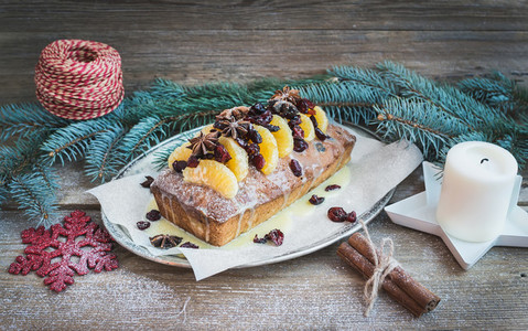 Christmas tangerine and cranberry spicy cake with holiday decora